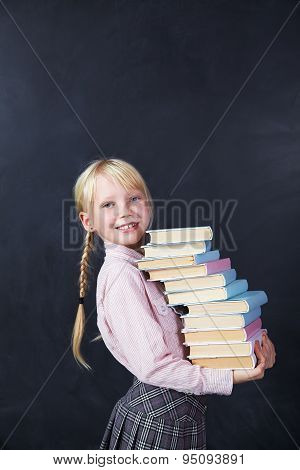 schoolchild on blackboard background