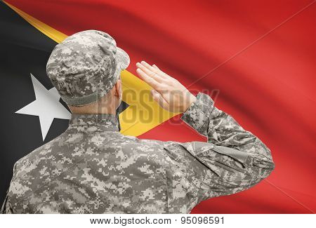 Soldier In Hat Facing National Flag Series - East Timor