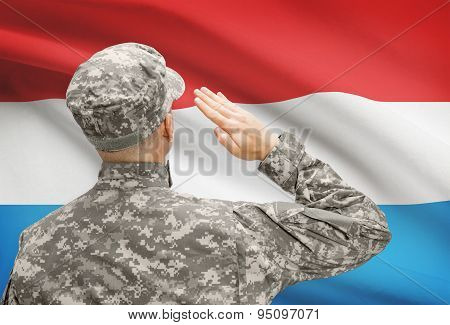 Soldier In Hat Facing National Flag Series - Luxembourg