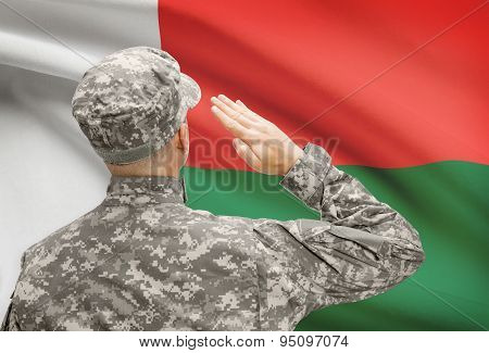 Soldier In Hat Facing National Flag Series - Madagascar