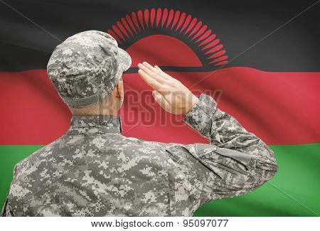 Soldier In Hat Facing National Flag Series - Malawi