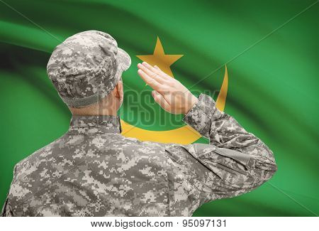 Soldier In Hat Facing National Flag Series - Mauritania