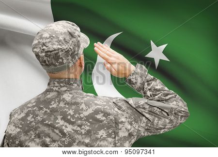 Soldier In Hat Facing National Flag Series - Pakistan