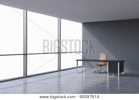 A Workplace In A Modern Panoramic Office, Copy Space On Windows. A Brown Leather Chair And A Black T