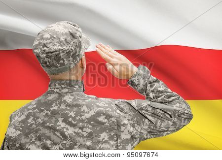 Soldier In Hat Facing National Flag Series - South Ossetia