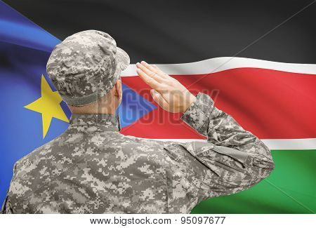 Soldier In Hat Facing National Flag Series - South Sudan