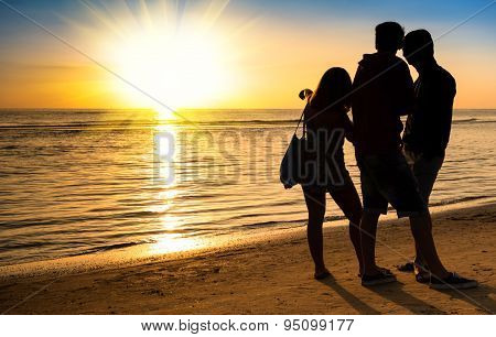 Group Of Best Friends Talking And Enjoying Sunset - Concept Of Carefree Youth Together