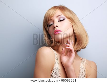 Beautiful Blond Hair Woman With Closed Eyes Touching Skin