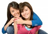 stock photo of sissy  - beautiful sisters smiling over a white background - JPG