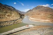 foto of jammu kashmir  - Confluence of the Indus and Zanskar Rivers in Ladakh Jammu and Kashmir state India - JPG