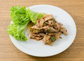 pic of thai cuisine  - Thai Cuisine and Food Thai Traditional Nam Tok or Spicy Sliced Grilled Beef Salad Served with Lettuce Leaves - JPG