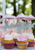 pic of ombres  - Dessert table for a party. Cake, cupcakes, sweetness and flowers. Shallow dof ** Note: Soft Focus at 100%, best at smaller sizes - JPG