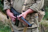 pic of sub-machine-gun  - American soldier with submachine gun second world war style - JPG