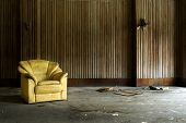 image of abandoned house  - arm chair in abandoned house at a deserted location - JPG