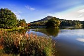 stock photo of blue ridge mountains  - Sharp Top mountain overlooking Abbott lake on the blue ridge parkway in Virginia