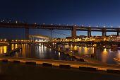 picture of bridges  - The 25th April bridge over Santo Amaro dock in Lisbon - JPG
