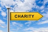 pic of word charity  - charity words on yellow road sign on blue sky - JPG