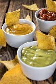 picture of nachos  - Three different nacho dips  - JPG