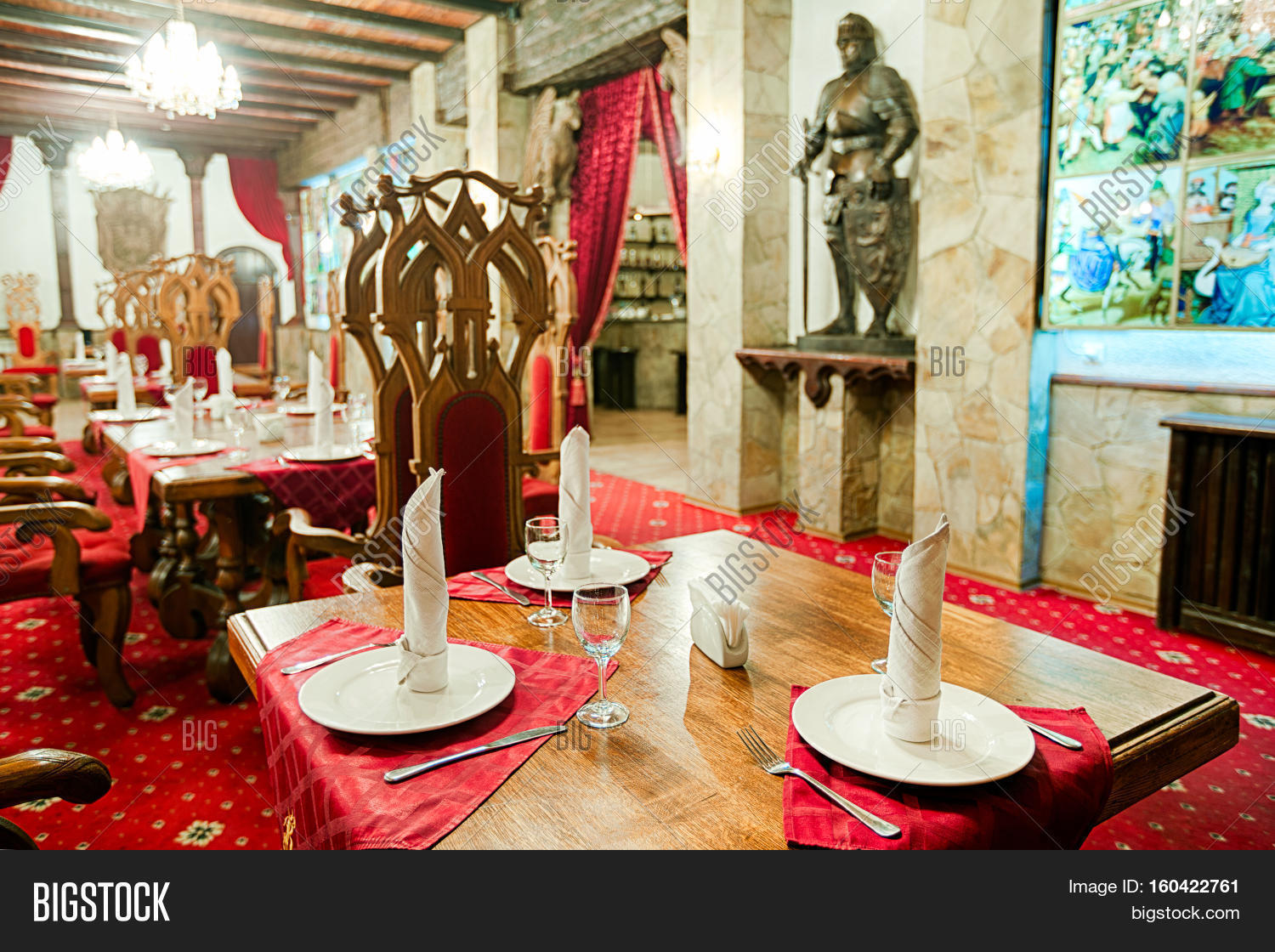 restaurant interior styled as ancient medieval castle, palace. red