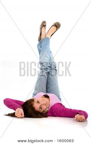 Beautiful Girl Portrait On The Floor