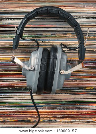 Audiophile headphones and a stack of old vinyl records