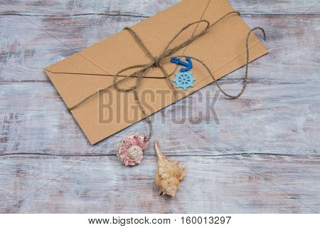 Kraft Envelope With Ornaments In Marine Style On Wooden Background