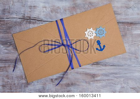 Kraft Envelope Decorated In Marine Style With Blue Ribbon