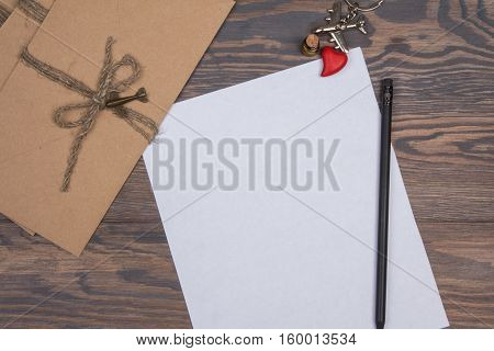 Envelope And Blank Sheet Of Paper On Wooden Background