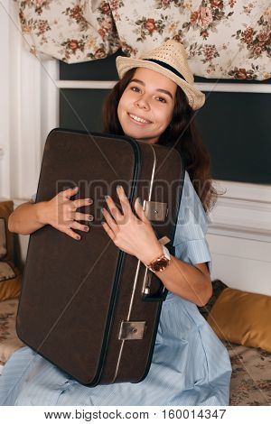 Woman with luggage get ready to travell.