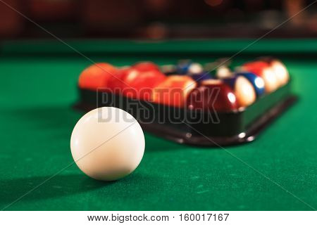 Ball and chalk on the billiard table.