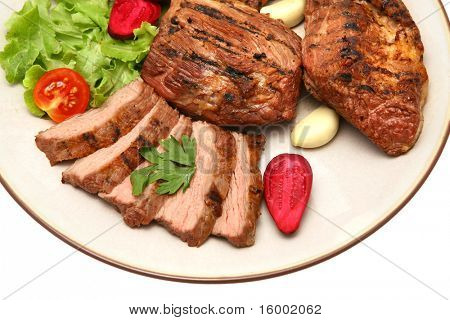 served roasted beef meat steak on color dish