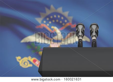 Pulpit And Two Microphones With Usa State Flag On Background - North Dakota