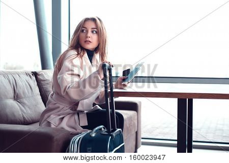 Woman sitting on the couch in a hall