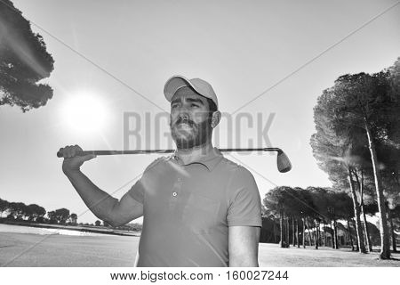 handsome middle eastern golfer portrait at golf course black and white