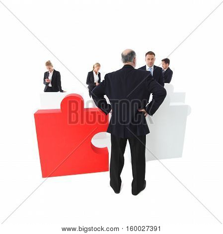Confused shocked surprised worker apologizes to manager part of puzzle team concept isolated on white