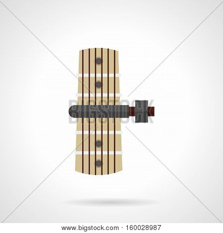 Image of capo on guitar fretboard. Accessories for musical instruments. Clip guitars for change in tone, chords. Flat color style vector icon.