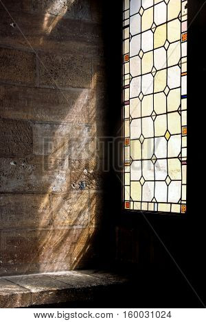 sunshine through Stained Glass Window on wall
