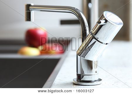 Stylish home tap and red apples