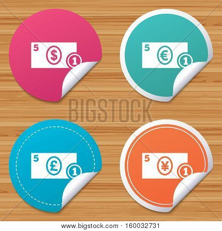 Round stickers or website banners. Businessman case icons. Dollar, yen, euro and pound currency sign symbols. Circle badges with bended corner. Vector