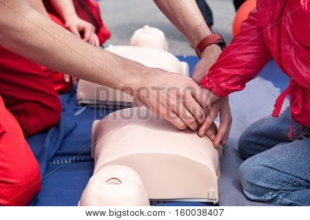 First aid training. Cardiopulmonary resuscitation - CPR. Chest compression.
