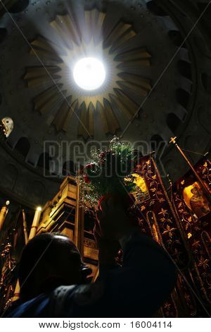 JERUSALEM - APRIL 18: Pilgrims come to Holy Sepulchre for Holy Fire (Holy Light) miracle ceremony on Holy Saturday April 18, 2009 in Jerusalem, Israel. About 10,000 worshipers attended the ceremony.