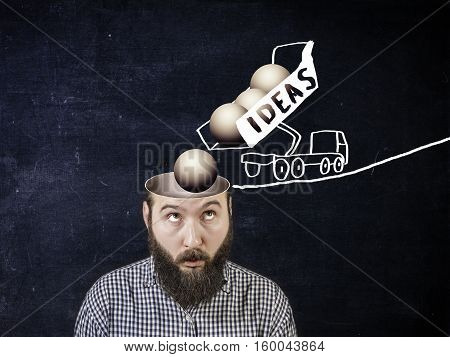 A new idea concept. Image truck pours out the cargo as a metaphor for the new ideas coming to mind a person. Eureka!