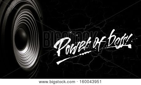 Black and white image of a membrane sound speaker on a black background with cracks. Photos contains handwritten text