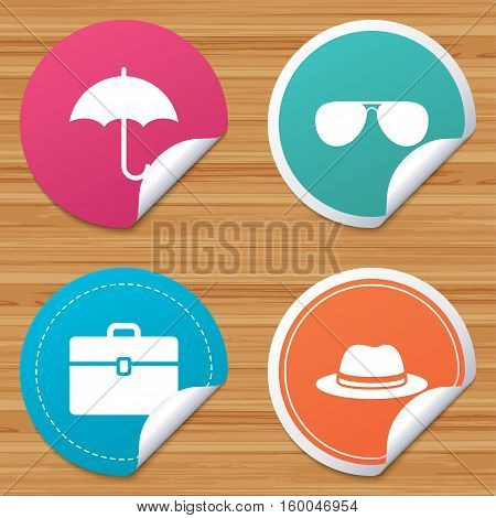 Round stickers or website banners. Clothing accessories icons. Umbrella and sunglasses signs. Headdress hat with business case symbols. Circle badges with bended corner. Vector