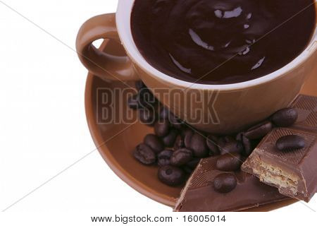 hot liquid chocolate and chocolate bar over white