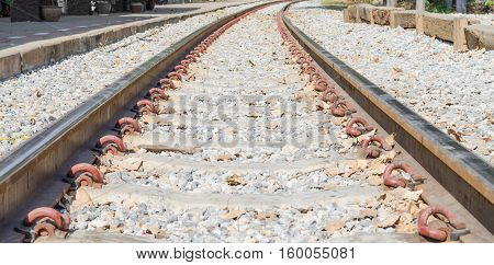 Old railroad tracks at a train station close up background