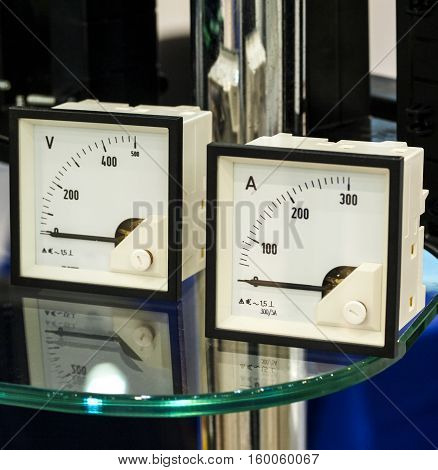 The ammeter and voltmeter on the table with glass