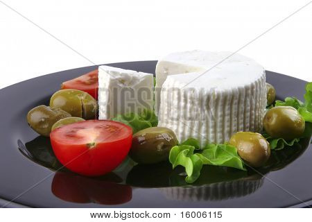 soft feta cheese served with tomato and olives