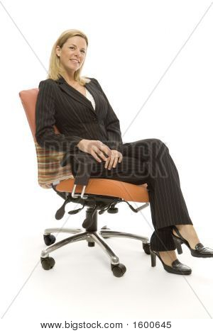 Businesswoman Sits Relaxing
