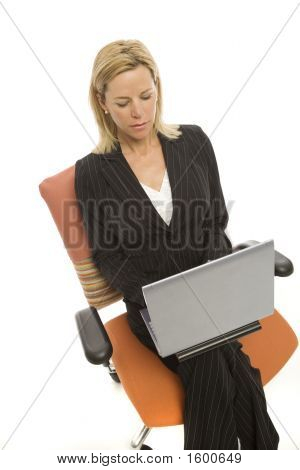 Businesswoman Sits With Laptop